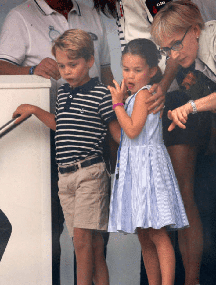 Charlotte, Louis and George watch their parents from a nearby boat at The King's Cup regatta, Isle of Wright | GettyImages