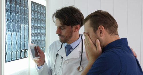 A young man receives bad news from his doctor. | Source: Shutterstock.