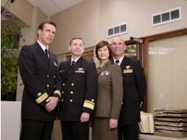 "RADM Don Guter with ""Commander Harmon ""Harm"" Rabb, Jr. (David James Elliott), Lt. Colonel Sarah ""Mac"" MacKenzie (Catherine Bell),  and ""JAG"" Admiral Chegwidden (John M. Jackson). 