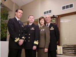"RADM Don Guter with ""Commander Harmon ""Harm"" Rabb, Jr. (David James Elliott), Lt. Colonel Sarah ""Mac"" MacKenzie (Catherine Bell),  and ""JAG"" Admiral Chegwidden (John M. Jackson). | Source: Wikimedia Commons."
