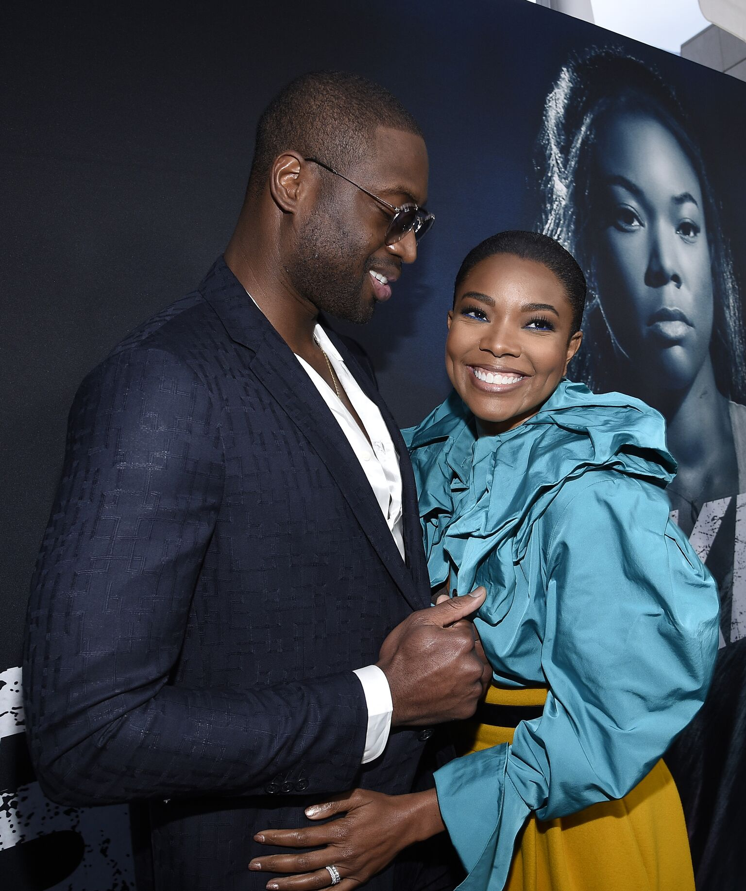 "Gabrielle Union and her husband basketball player for the Miami Heat Dwyane Wade arrive for Universal Pictures' special screening of the film ""Breaking In"" at ArcLight Cinemas 