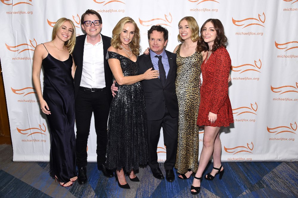 """Aquinnah Fox, Sam Fox, Tracy Pollan, Michael J. Fox, Schuyler Fox, and Esme Fox attending """"A Funny Thing Happened On The Way To Cure Parkinson's"""" in New York City, in November 2019. 