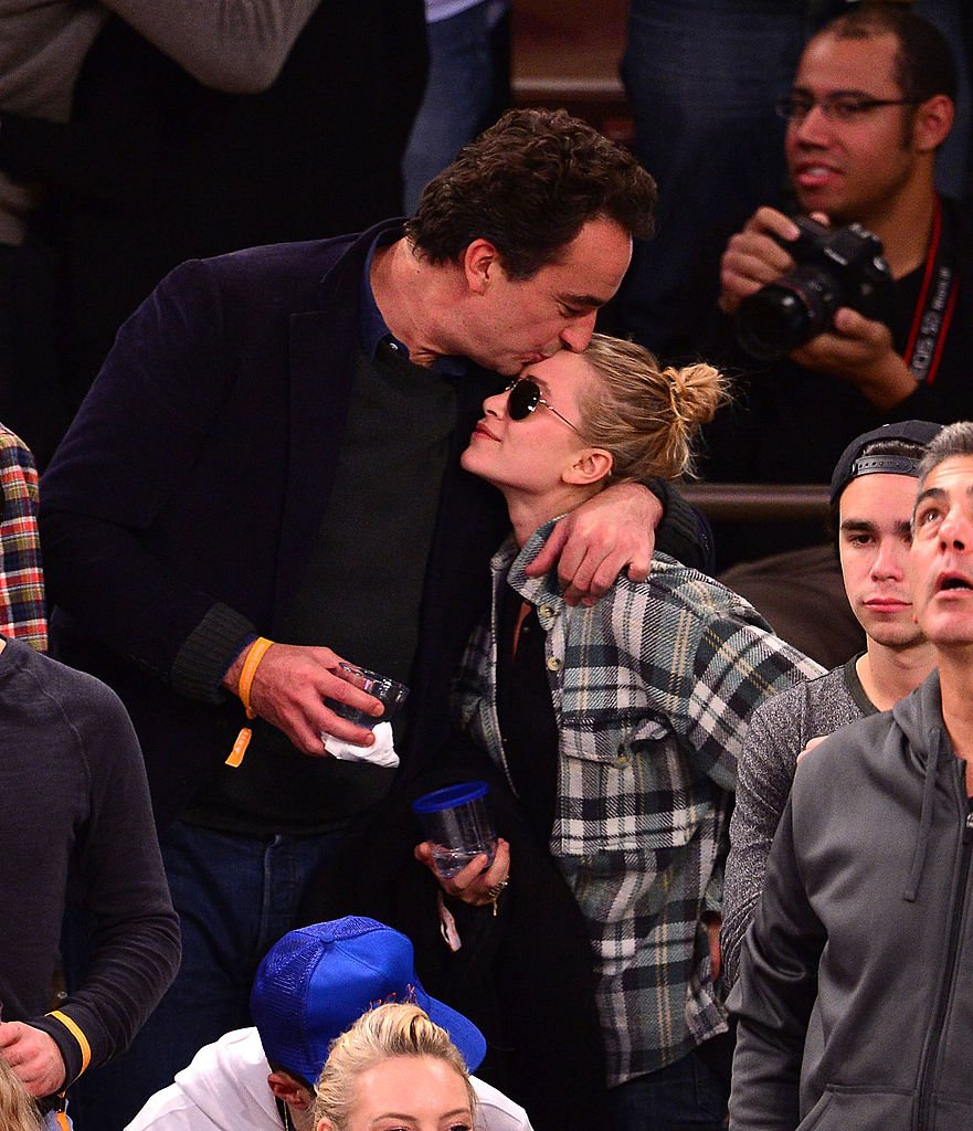 Mary-Kate Olsen and Olivier Sarkozy attend the New York Knicks vs Minnesota Timberwolves game in New York City on November 3, 2013 | Photo: Getty Images