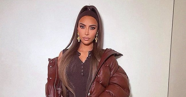 Kim Kardashian Dons Brown Patent Trousers with a Matching Top & Snakeskin Boots — See Her Look