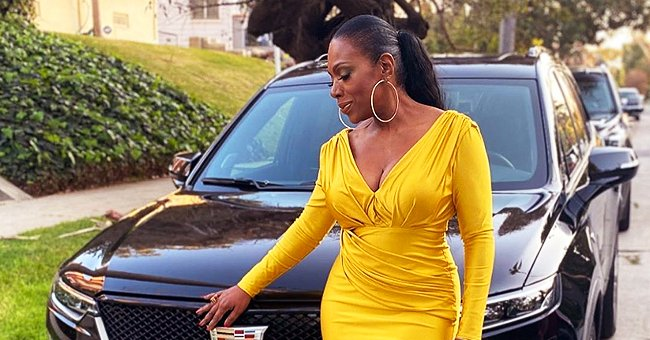 Sheryl Lee Ralph Stuns in Bright Yellow Gown Posing against Black Car before Attending the American Black Film Festival