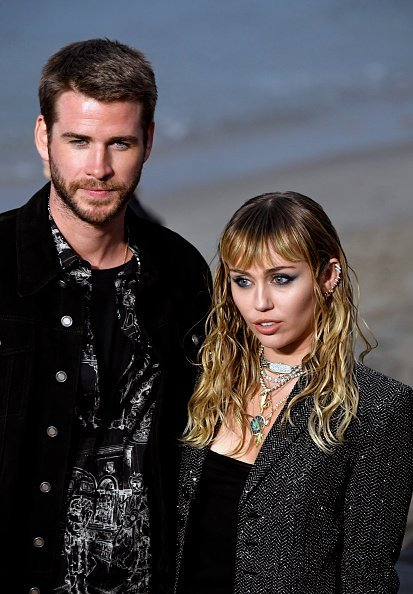Liam Hemsworth and Miley Cyrus at the Saint Laurent Mens Spring Summer 20 Show on June 06, 2019 | Photo: Getty Images
