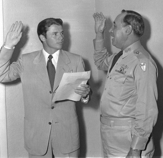 Captain Audie Murphy is sworn in to the Texas National Guard by U. S. Army Major General H. Miller Ainsworth 14 July 1950   Source: Wikimedia Commons Images