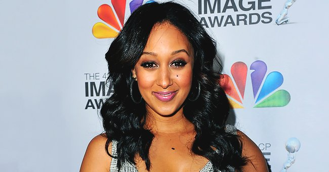 Tamera Mowry Gives Workout Tip as She Does Stretches in Tight Black Training Pants