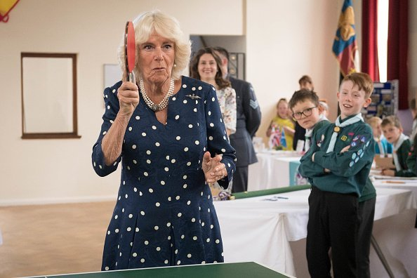 Camilla, Duchess of Cornwall playing table tennis during a visit to Royal Air Force Halton, as part of its centenary year celebrations at RAF Halton in Aylesbury, England.| Photo: Getty Images.