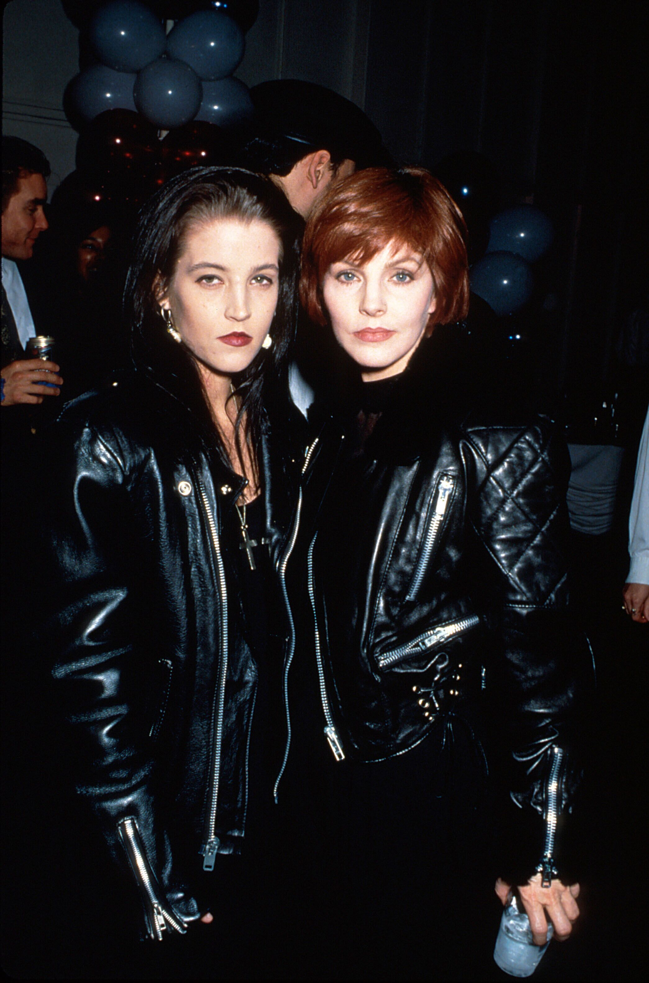Lisa Marie Presley and mother, actress Priscilla Presley, both wearing Elvis-style black leather jackets | Source: Getty Images