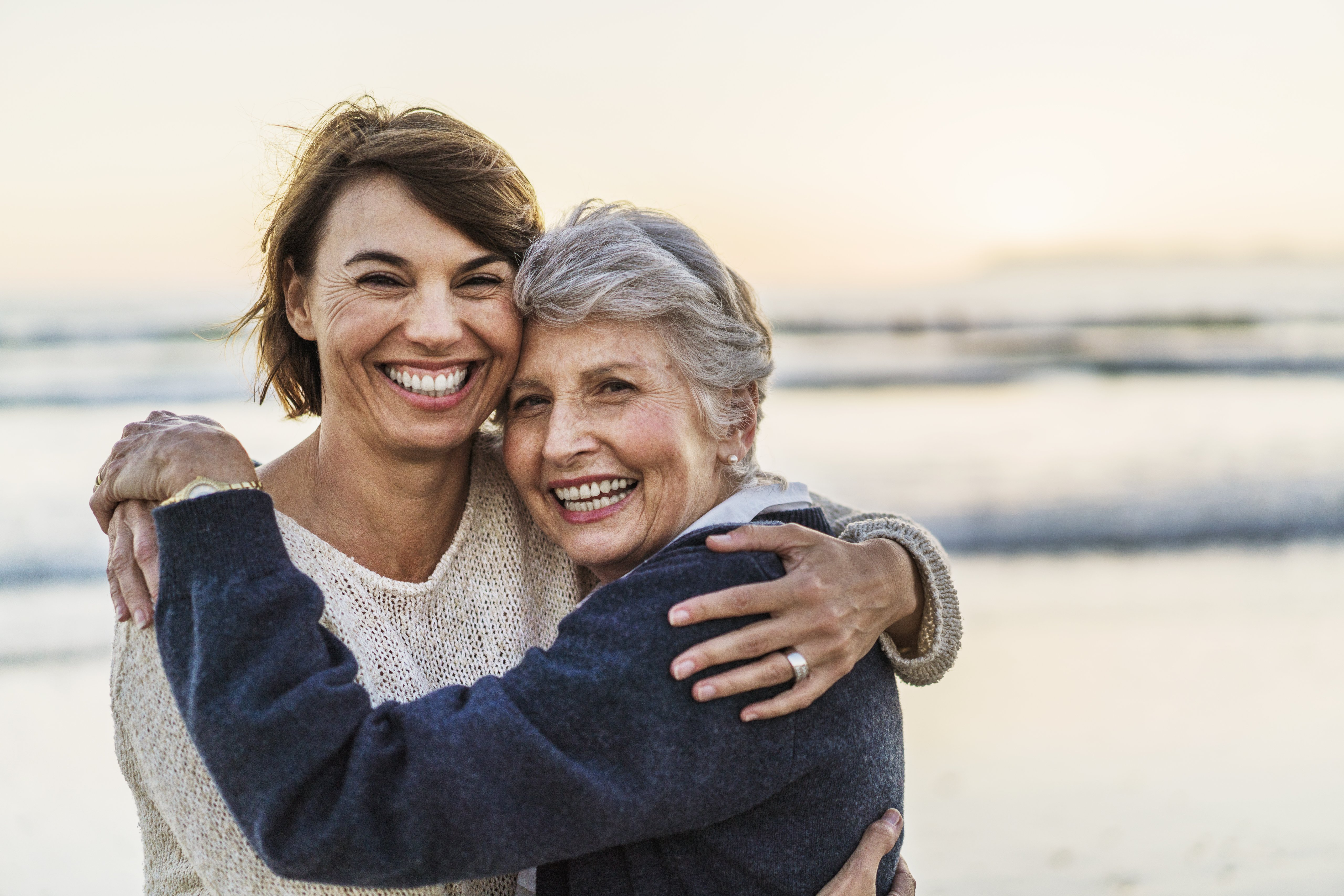 A photo of happy mother embracing female. Portrait of daughter with senior woman. They are at beach.|Photo: Getty Images