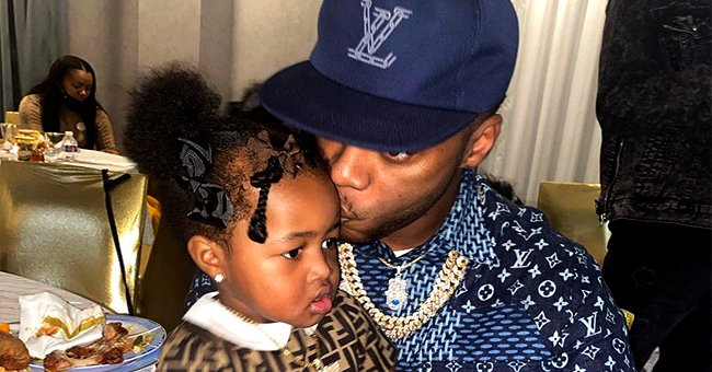 Remy Ma & Her Husband Papoose Snuggle with Daughter Reminisce Dressed in a $460 Fendi Dress