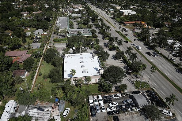 The AutoZone at 801 S. State Road 7 is seen (the building with the white roof) where Cesar Sayoc was arrested in on October 26, 2018, in Plantation, Florida. | Source: Getty Images.