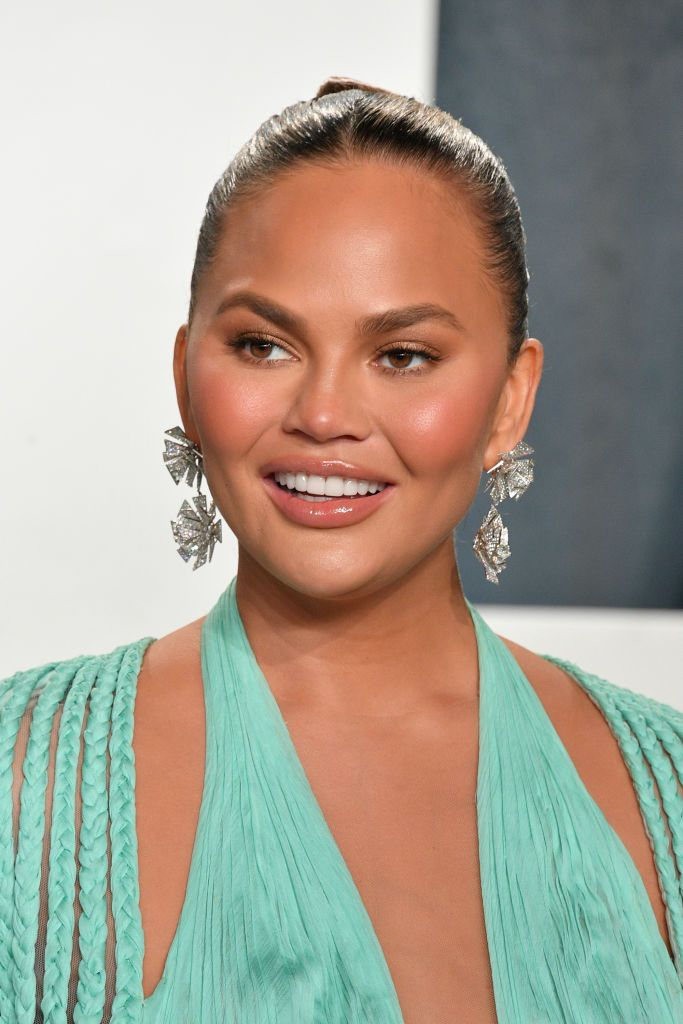 "Chrissy Teigen at the ""Vanity Fair"" Oscar party at Wallis Annenberg Center for the Performing Arts on February 09, 2020, in Beverly Hills, California 
