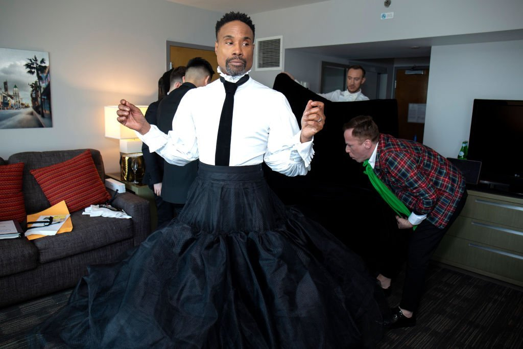 Billy Porter stands in the middle of a hotel room as a team of stylists help him prepare for the 91st Academy Awards at Lowes Hollywood Hotel, on February 24, 2019, in Hollywood, California | Source: Santiago Felipe/Getty Images