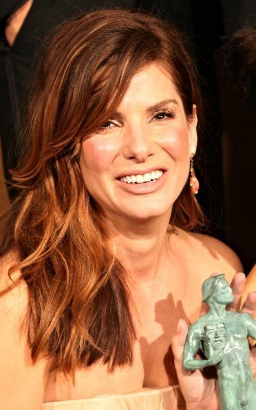 """Sandra Bullock of """"Crash"""" with the award for Outstanding Cast of a Motion Picture poses in the press room during the 12th Annual Screen Actors Guild Awards 