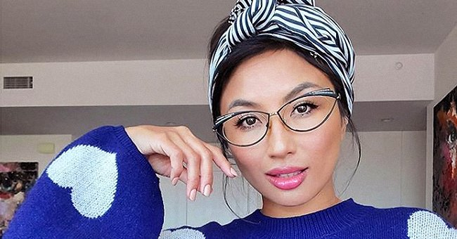 Jeannie Mai of 'The Real' Teases Fans about Upcoming Project While Wearing a Blue Sweater and Striped Headband