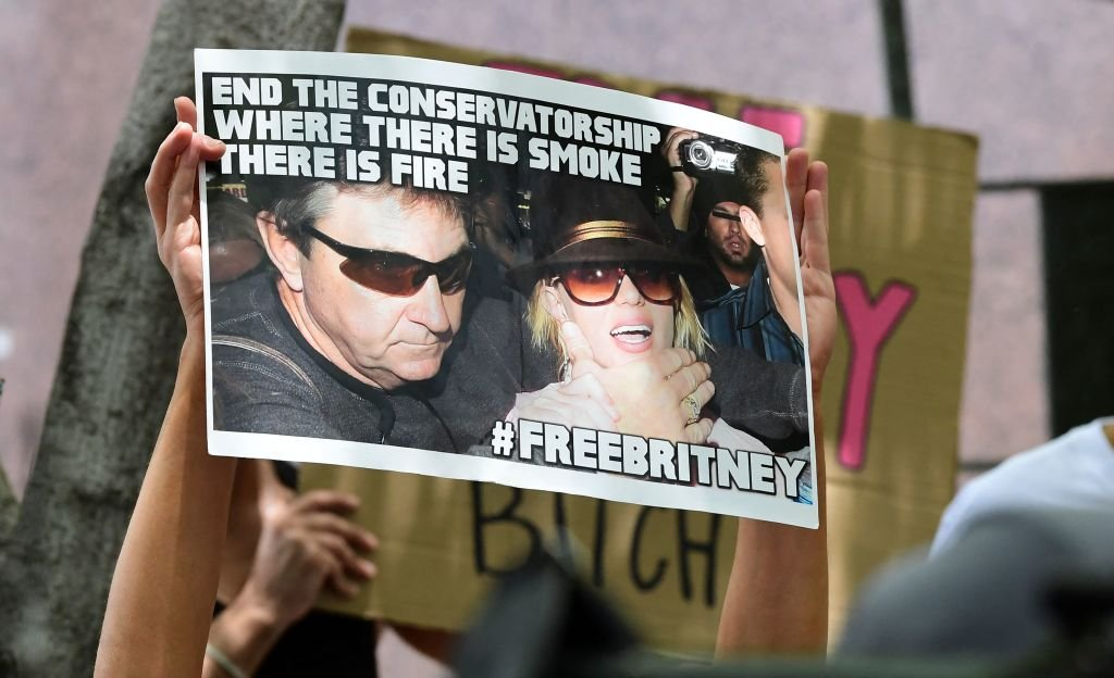 Fans and supporters of Britney Spears hold placards as they gather outside the County Courthouse in Los Angeles, June 2021 | Source: Getty Images