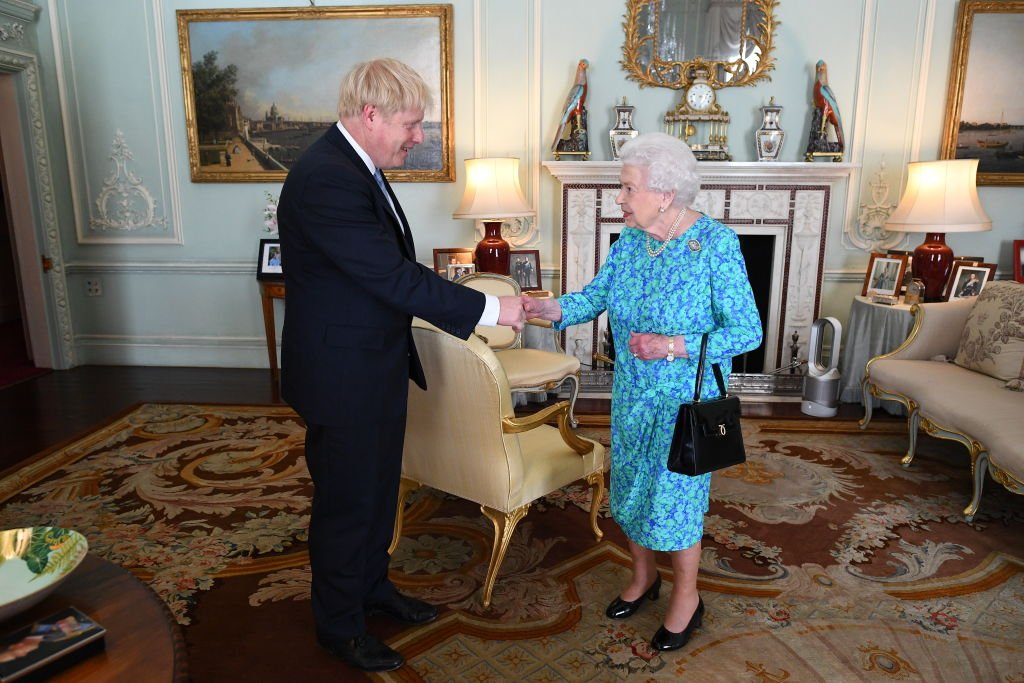 Queen Elizabeth II welcomes newly elected  Boris Johnson in Buckingham Palace on July 24, 2019, in London, England. | Source: Getty Images.