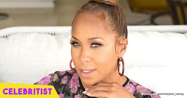 Marjorie Harvey holds her newborn grandson in her arms in heart-melting picture