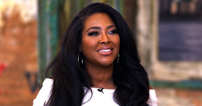Kenya Moore Shares Kiss with Daughter Brooklyn Looking Cute Rocking a Pink Swimsuit in a Pool