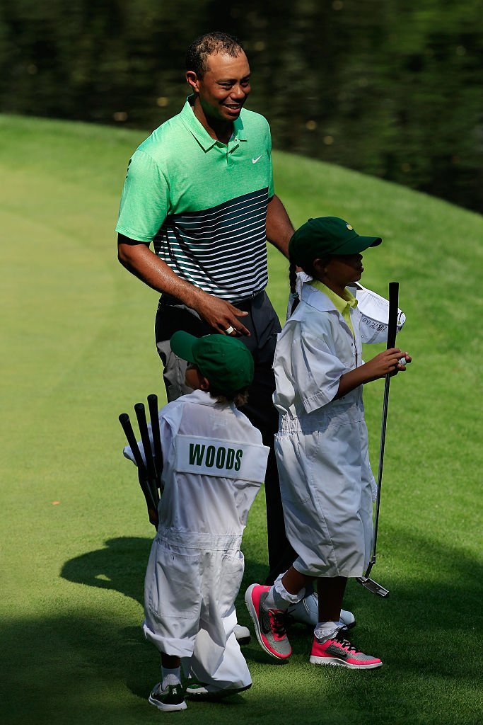 Tiger Woods with his son, Charlie Axel and daughter, Sam Alexis during the Par 3 Contest before the start of the 2015 Masters Tournament in Augusta on April 8, 2015. | Source: Getty Images