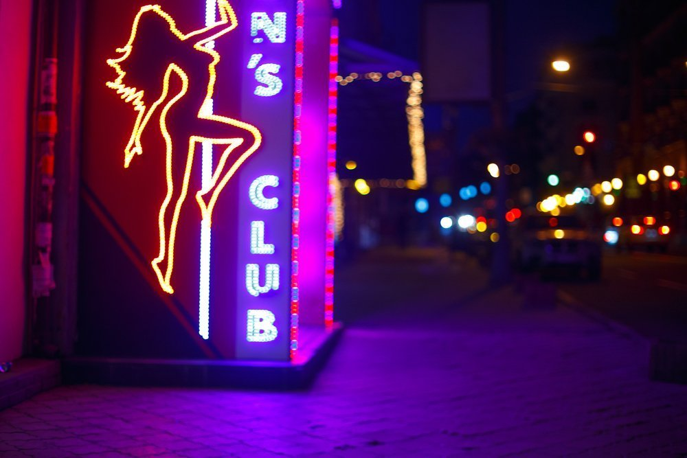 Neon Signs of A Men's Club :Photo: Shutterstock