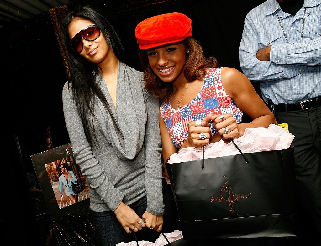 Nicole Scherzinger and Melody Thorton of pose with Baby Phat during The Bratz Forever Diamondz Lounge, September 2006   Source: Getty Images