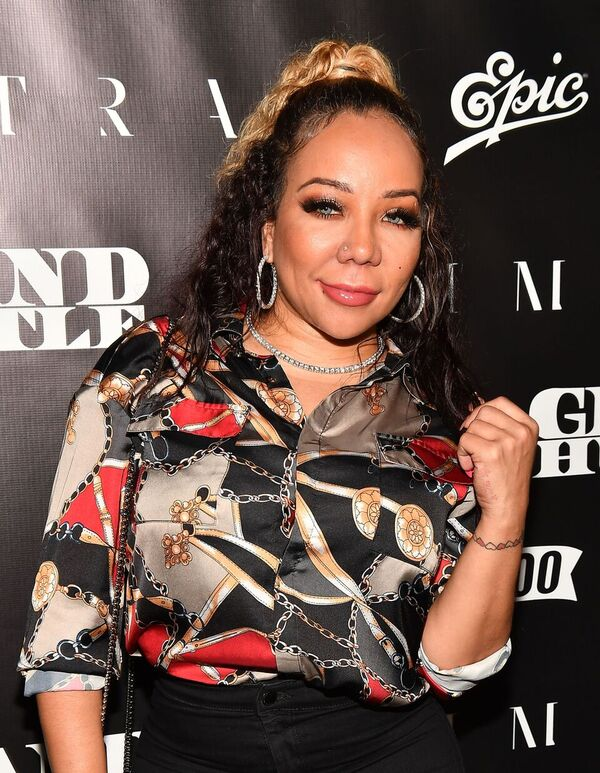 """Tameka """"Tiny"""" Harris at a red carpet event 