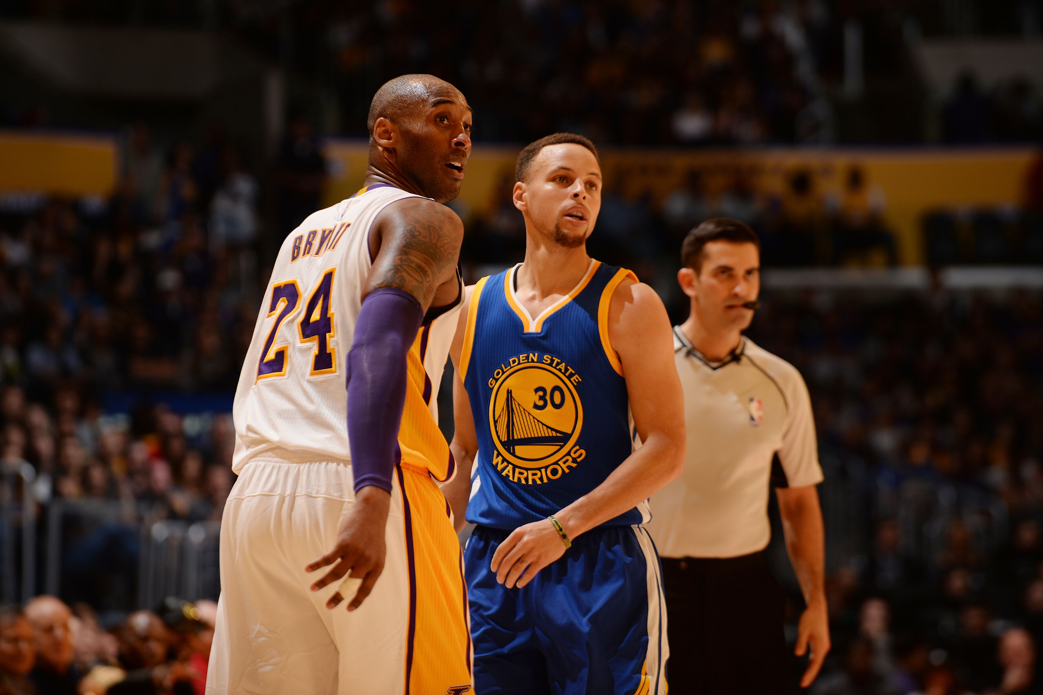 Kobe Bryant stands on the court against Stephen Curry on March 6, 2016 at STAPLES Center in Los Angeles. | Source: Getty Images