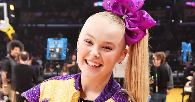 JoJo Siwa ata basketball game between the Los Angeles Lakers and Phoenix Suns at Staples Center on February 10, 2020, in Los Angeles, California | Photo:Allen Berezovsky/Getty Images
