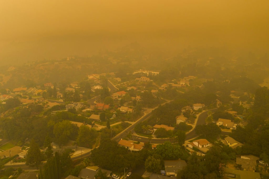An aerial view shows neighborhoods enshrouded in smoke as the Bobcat Fire burns East of Los Angeles. September 13, 2020 | Source: Getty Images