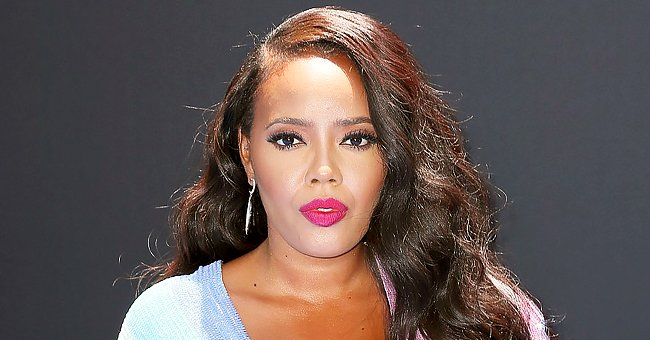 Check Out Angela Simmons' Slim Legs as She Poses in Pink Pants with Matching High Heel Shoes