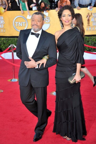 Laurence Fishburne (L) and Gina Torres arrive at the 18th Annual Screen Actors Guild Awards at The Shrine Auditorium on January 29, 2012, in Los Angeles, California. | Source: Getty Images.