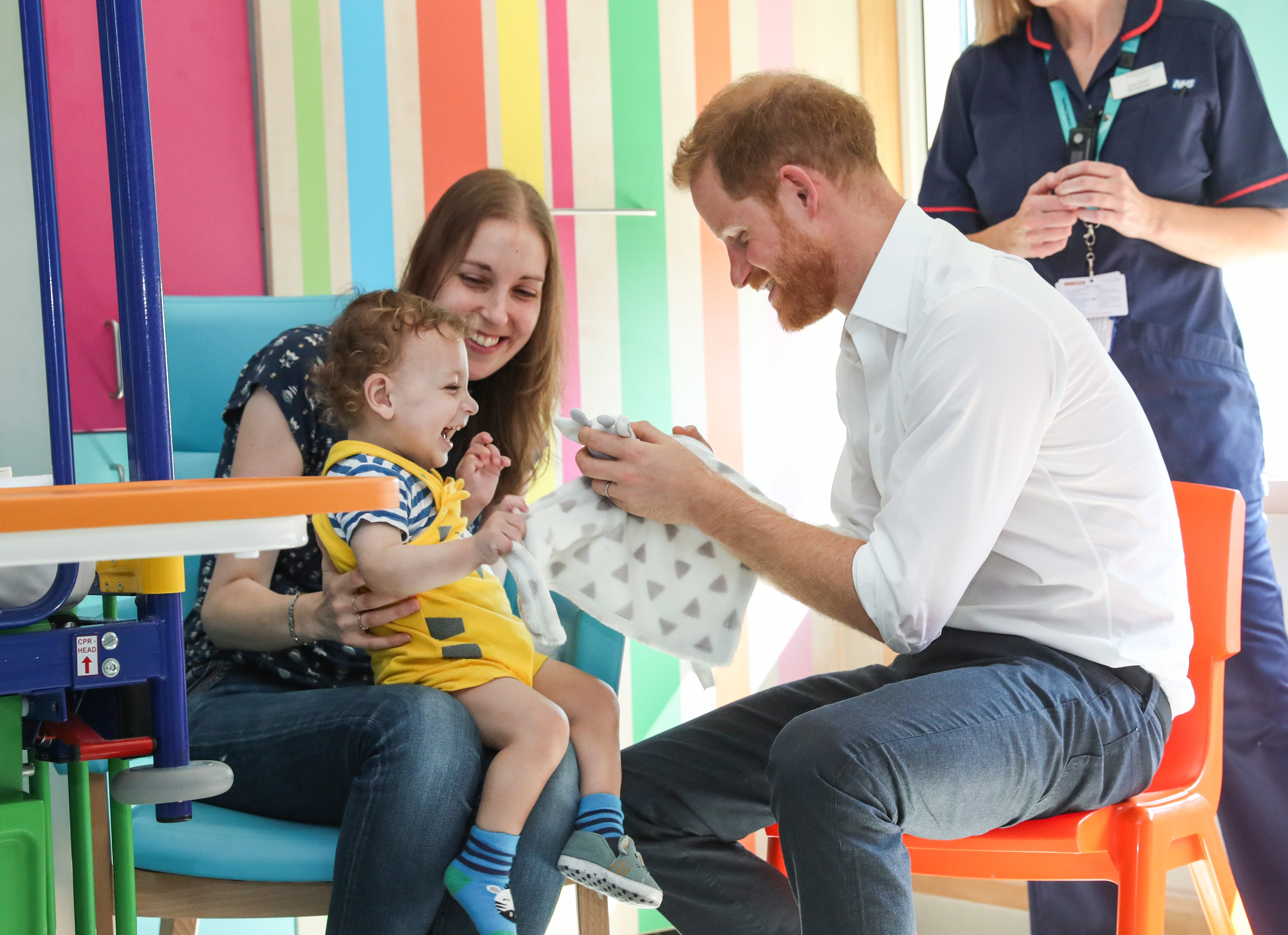 Prince Harry interacts with Noah Nicholson during a visit to Sheffield Children's Hospital on Thursday July 26, 2019 | Photo:Getty Images