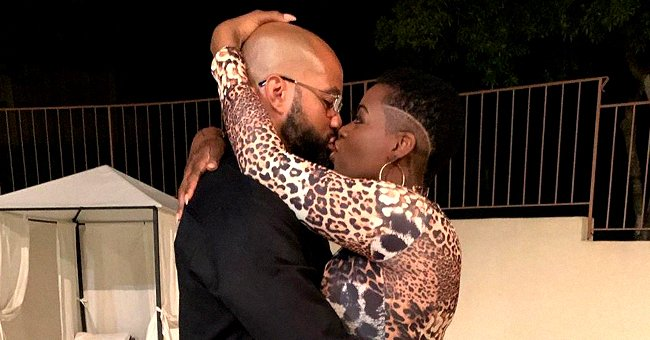 'American Idol' Alum Fantasia Barrino Stuns in Leopard Dress & High Heels and Grooves with Husband