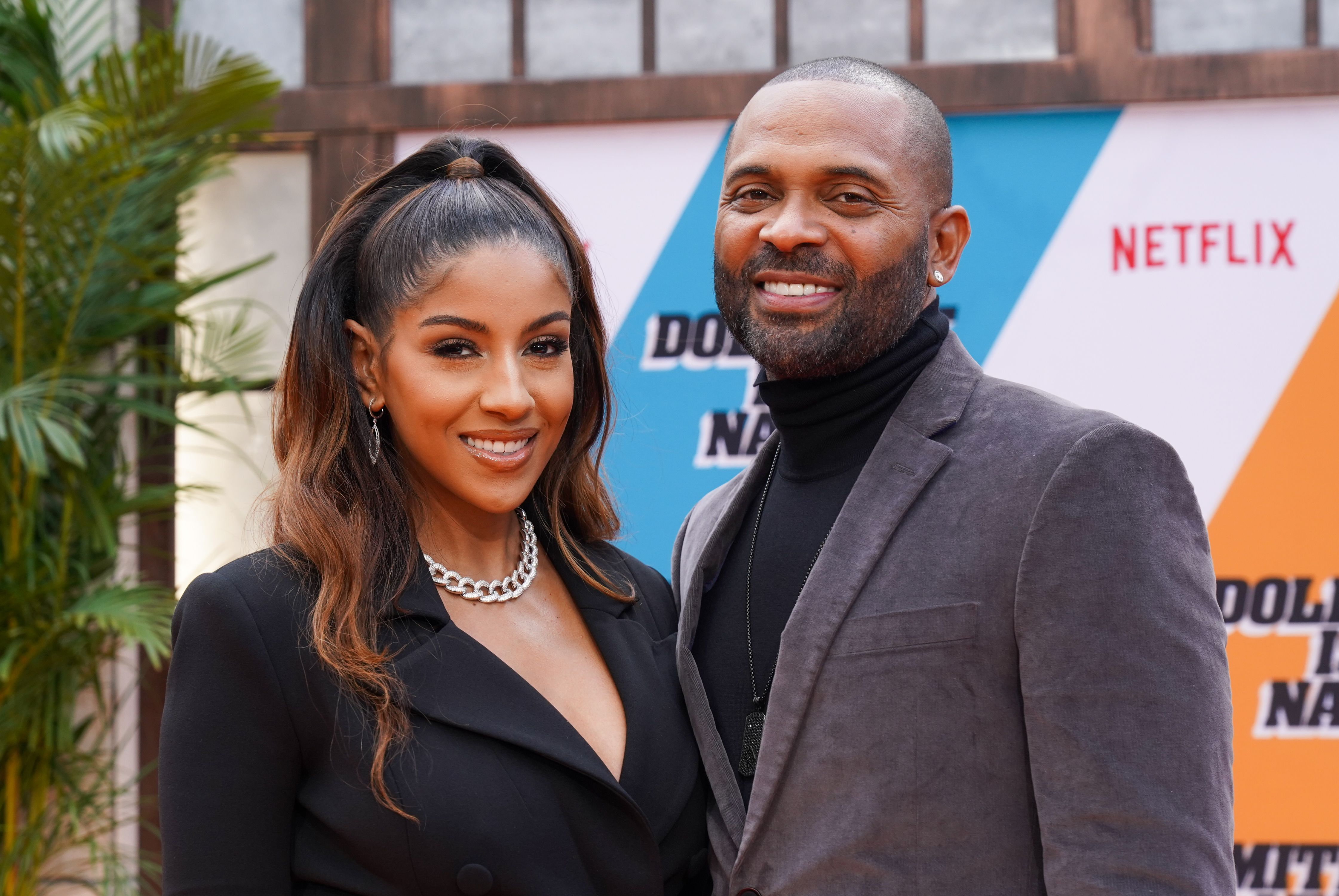 """Mike Epps and Kyra Robinson attend the premiere of Netflix's """"Dolemite Is My Name"""" on September 28, 2019 at Regency Village Theatre  