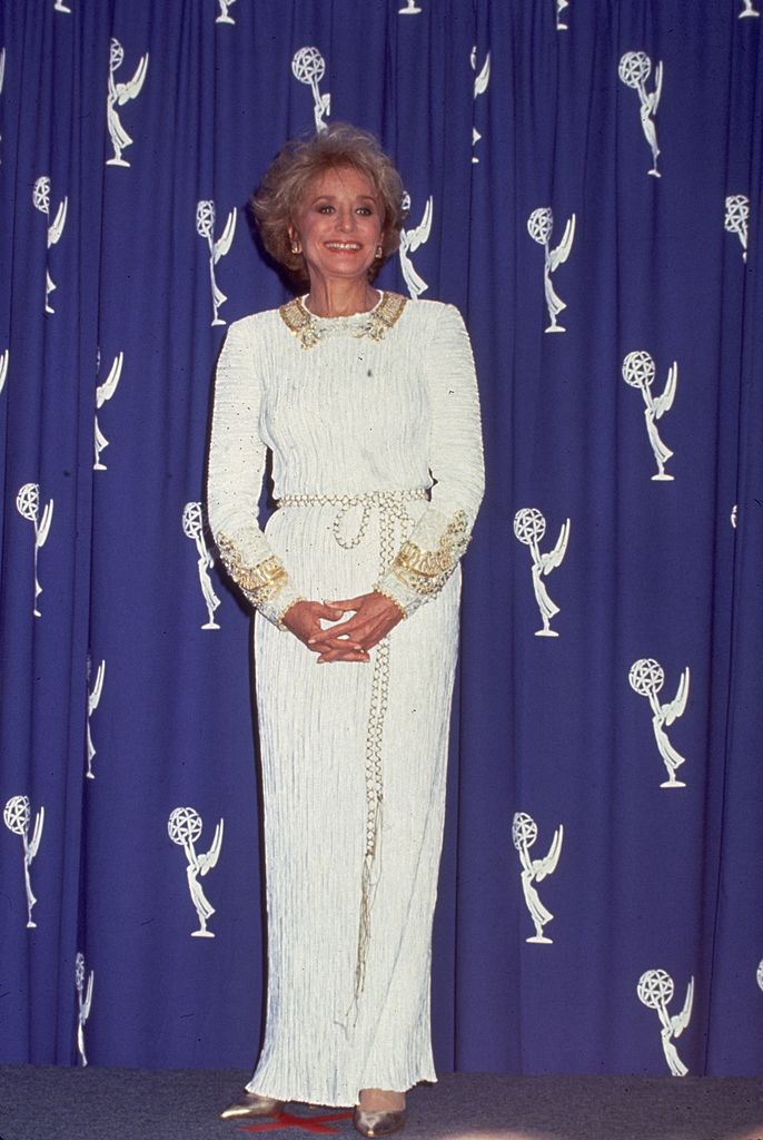 : Barbara Walters, American broadcast news anchor and television host poses for photographers at the Pasadena Civic Auditorium during the Emmy Award ceremonies for 1993. Walters was awarded an Emmy for 'Outstanding Information Special.'   Source: Getty Images