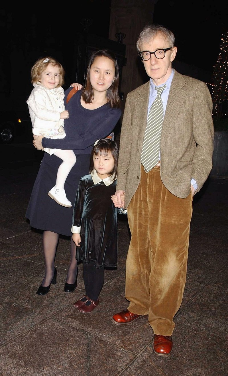 Woody Allen and his family, daughter Manzie, wife Soon-Yi and daughter Bechet on December 31, 2003 in New York City | Photo: Getty Images
