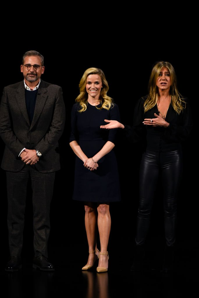 Steve Carrell, Reese Witherspoon, and Jennifer Aniston during an Apple product launch event.   Source: Getty Images