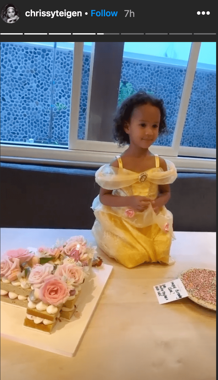 Chrissy Teigen shared a photo of her daughter Luna Stevenson sitting on a table in front of two birthday cakes for her fourth birthday | Source: Instagram.com/chrissyteigen