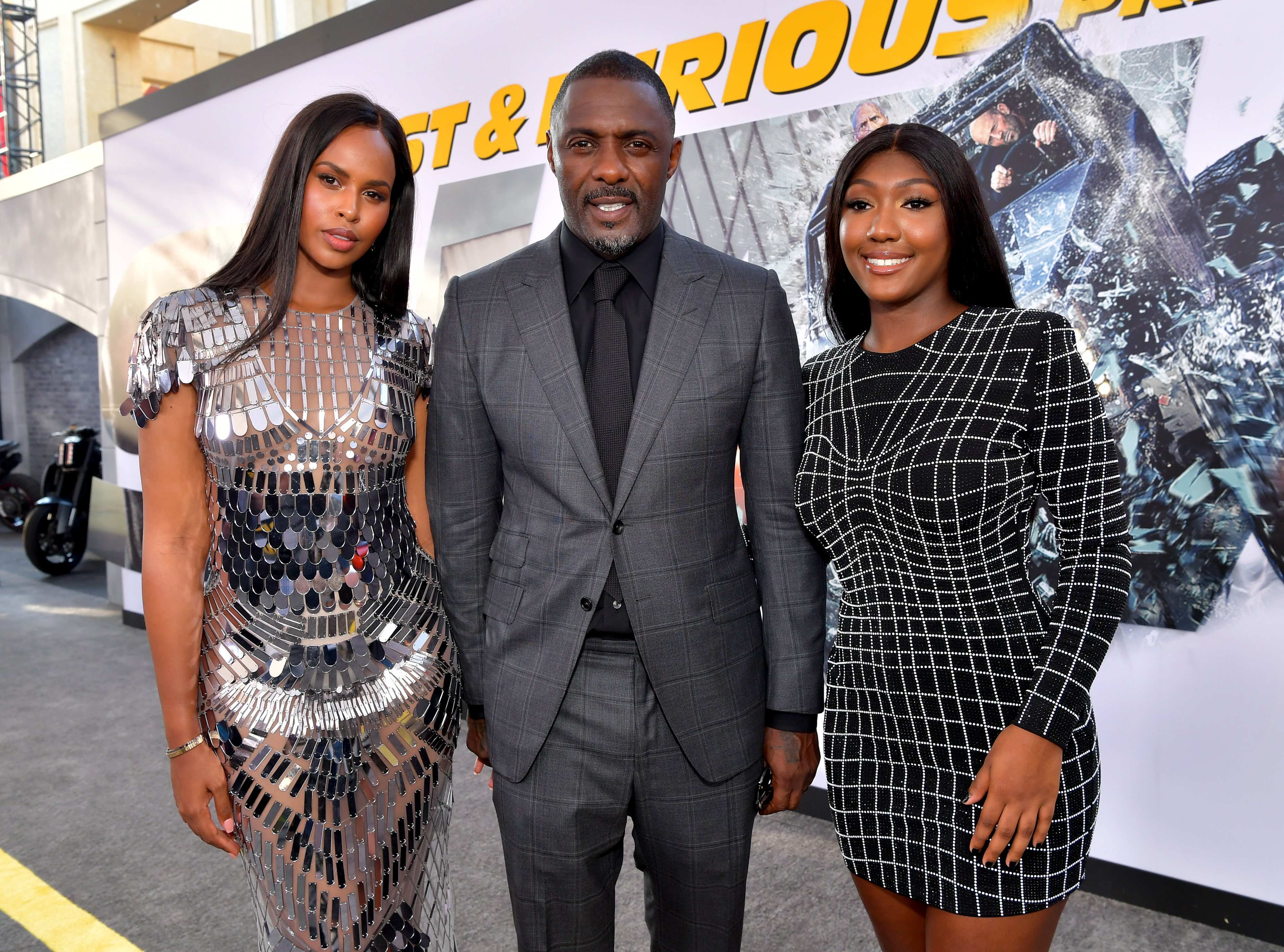 "(L-R) Sabrina Dhowre Elba, Idris Elba, & Isan Elba at the premiere of ""Fast & Furious Presents: Hobbs & Shaw"" in Hollywood, California on July 13, 2019. 