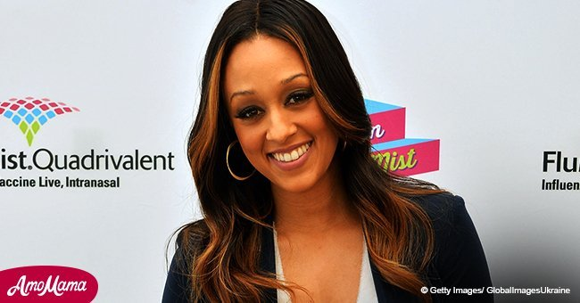 Tia Mowry shares a sweet throwback photo with her twin sister. The two had the cutest smiles