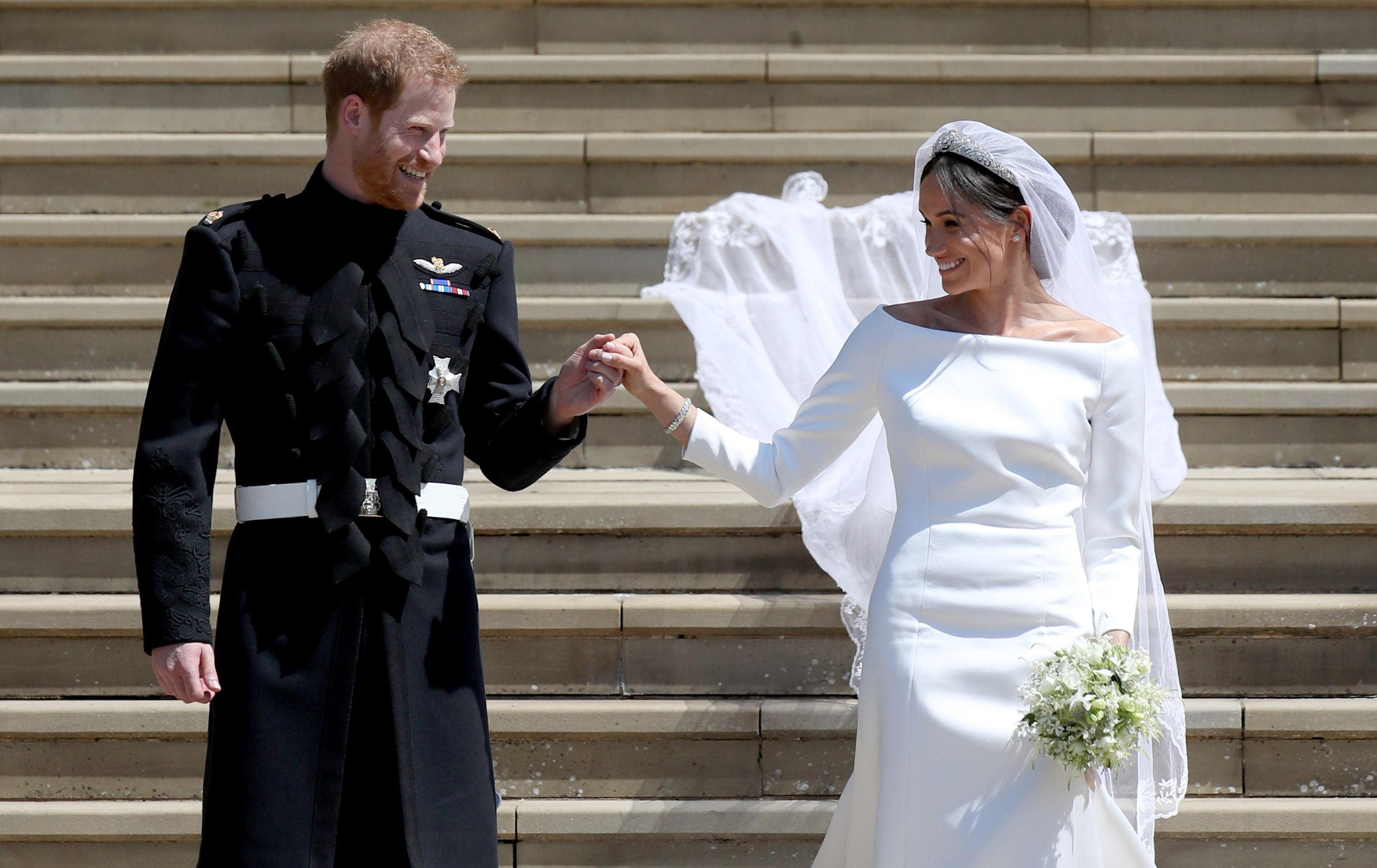 Prince Harry and Meghan Markle depart after their wedding ceremony at St George's Chapel at Windsor Castle on May 19, 2018 in Windsor, England.   Photo: Getty Images