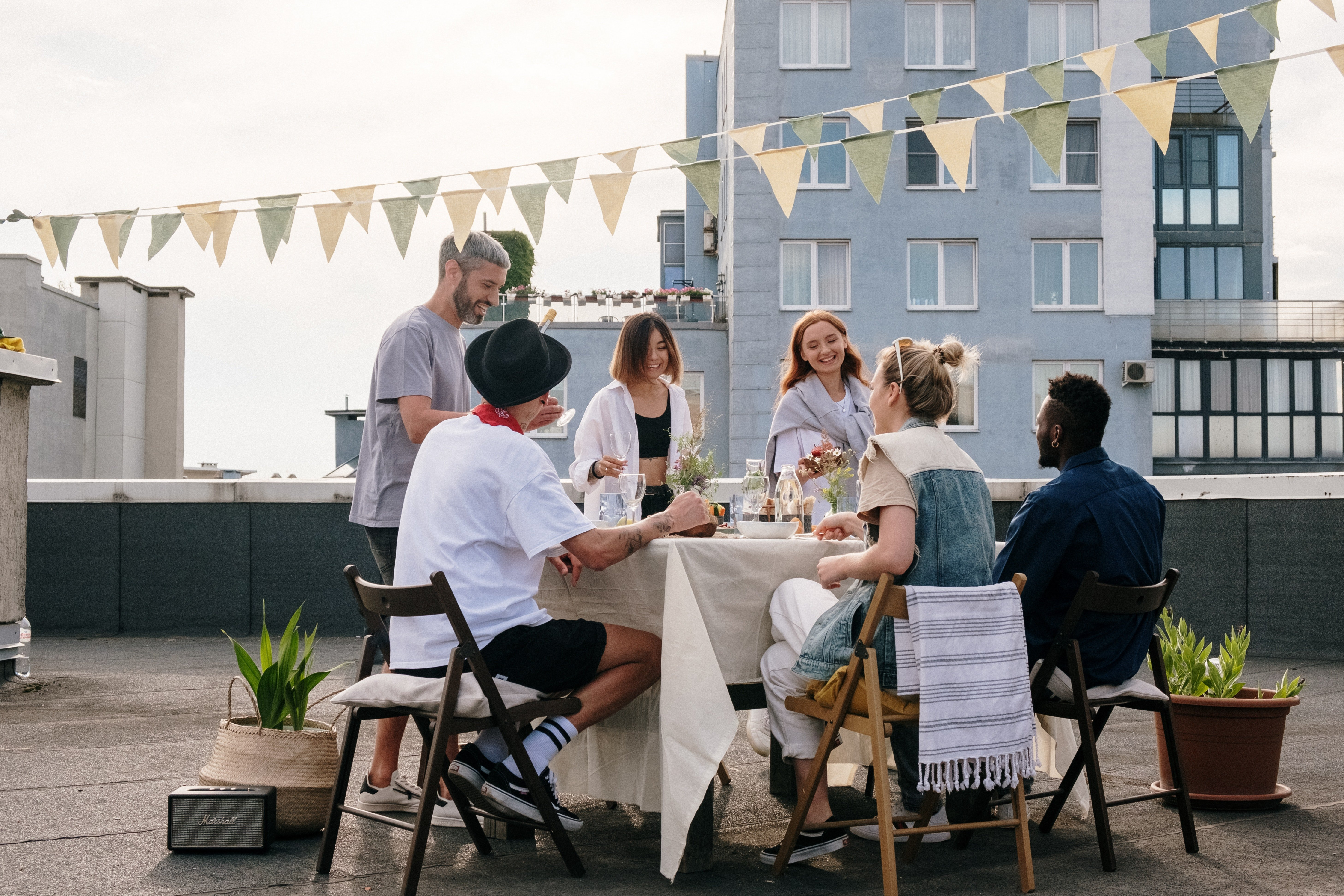 A roof top dinner party.   Pexels
