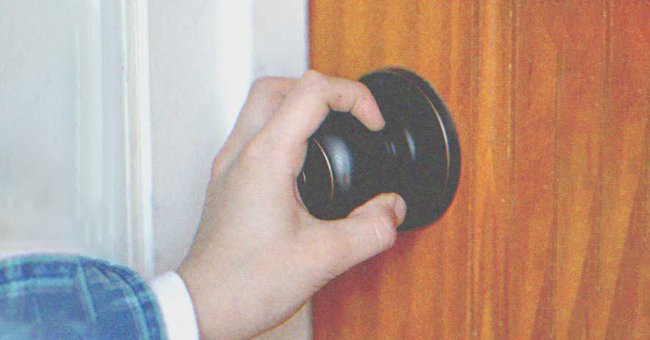 Tim tried to run out of the house but the door was locked | Source: Shutterstock