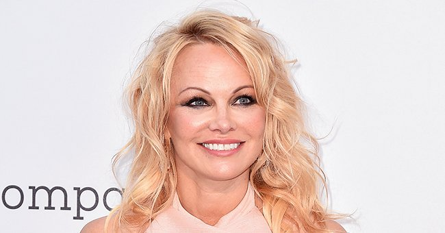 Pamela Anderson, 53, Flaunts Her Phenomenal Figure as She Poses on a Bed in New Photos
