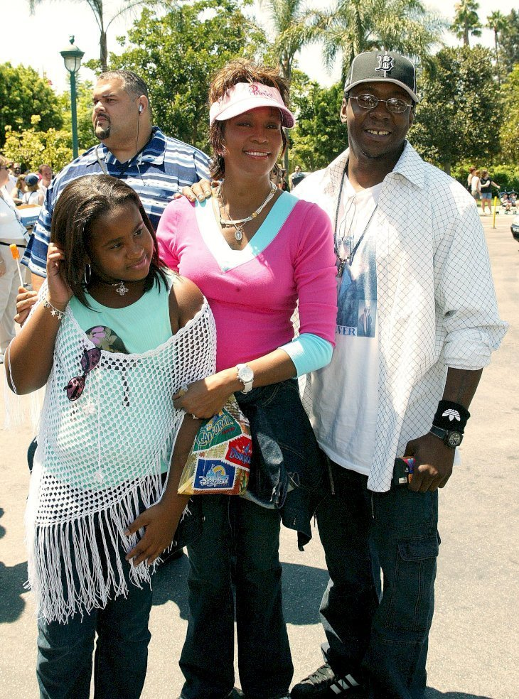 Late Whitney Houston, Bobby Brown and their daughter, late Bobbi Kristina at Disneyland on Aug. 7, 2004 | Photo: Getty Images