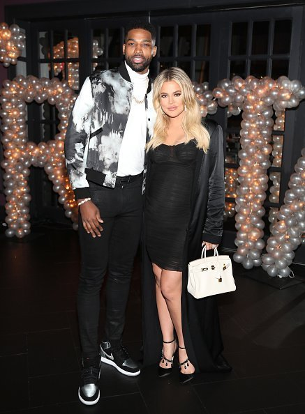 Tristan Thompson and Khloe Kardashian pose for a photo as Remy Martin celebrates Tristan Thompson's Birthday at Beauty & Essex on March 10, 2018 in Los Angeles, California | Photo: Getty Images