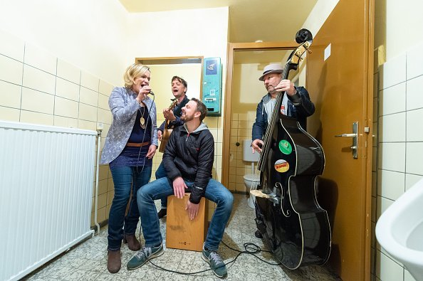 A music band pictured having fun in the restroom   Photo: Getty Images